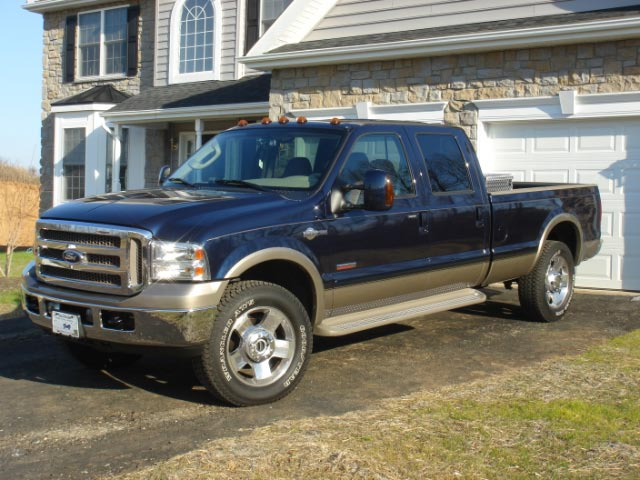 guys have any pics of lowered or stock hight F250 on some nice 20'' + wheels ?? thank-dsc00752.jpg