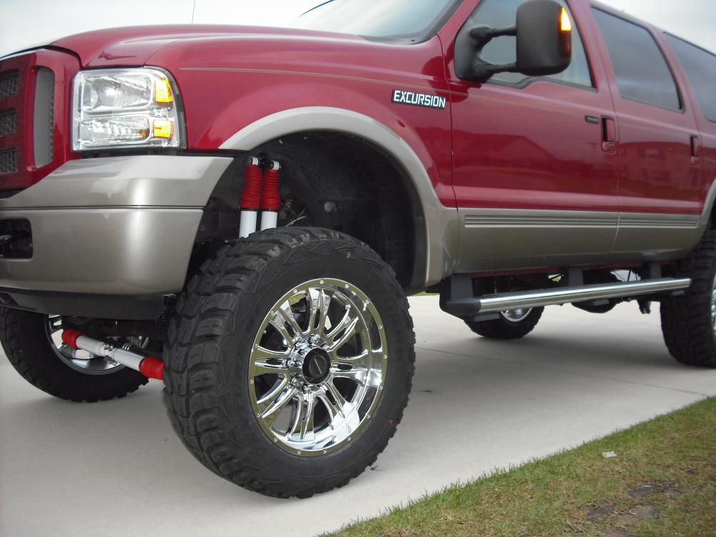new pic of my ex lifted and new wheels and tires-dscf1238.jpg