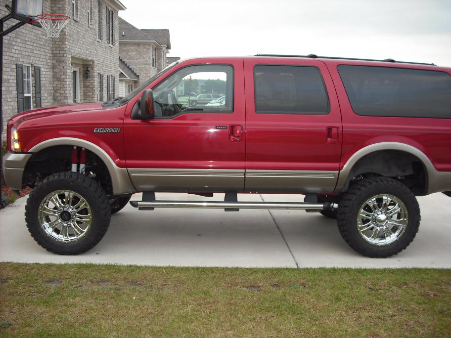 new pic of my ex lifted and new wheels and tires-dscf1239.jpg