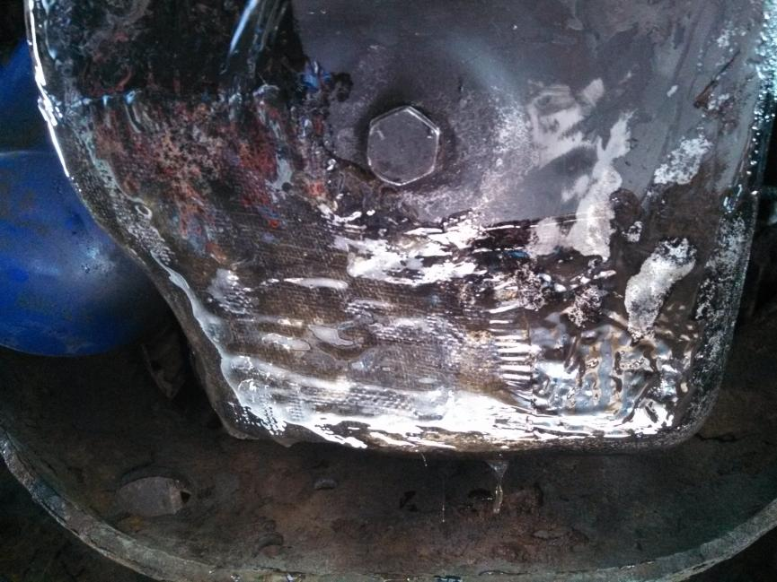 oil pan woes... WHOA...-fiberglass-patch.jpg