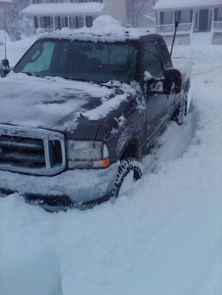 Truck with lt305 70r16 e and highly worn kumho kl78 at s 30 quot of snow