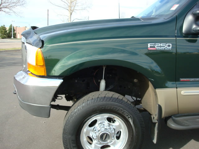 Just bought this f250 7.3 is it lifted?-front.jpg