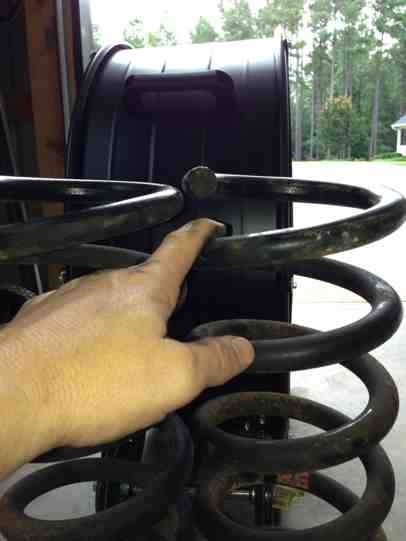 Shimming front drivers coil after lift...-imageuploadedbyautoguide1372542655.947869.jpg
