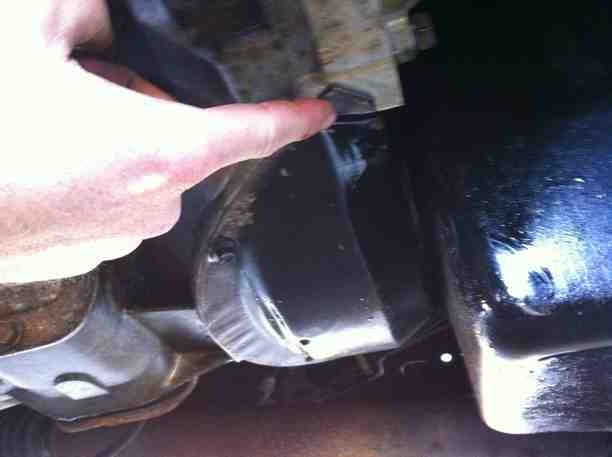 Oil leaks from inspection plate an burning oil.-imageuploadedbyautoguide1374853242.741948.jpg