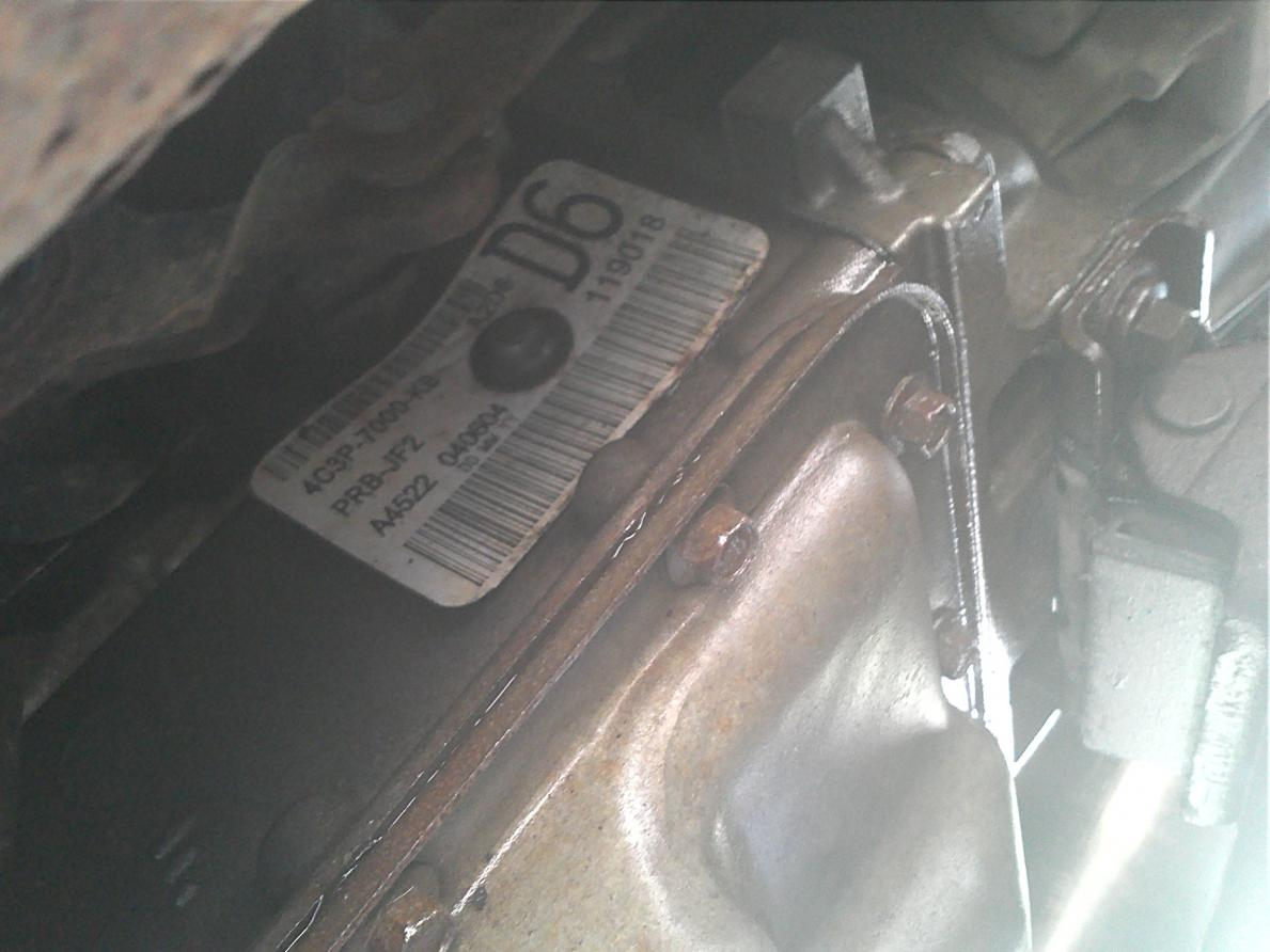 Transmission leaking fluid rear of tran oil pan-nick.jpg