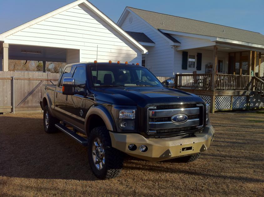 Tan bedlined road armor f&r bumpers and 35x12.50s installing right now!-photo-2.jpg