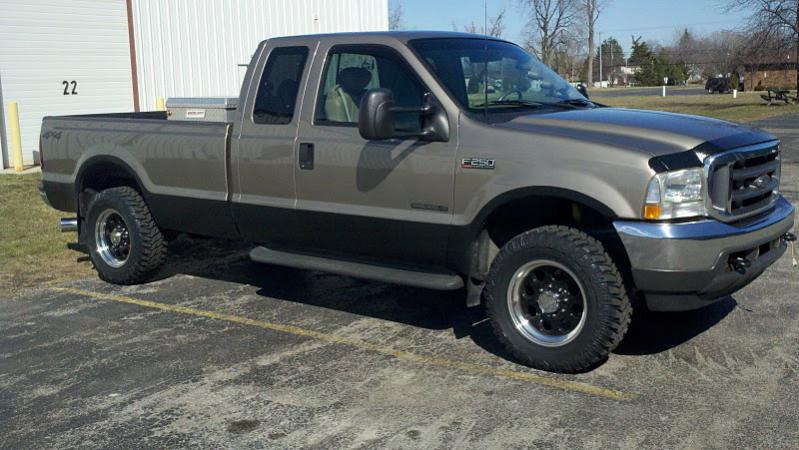Just ordered my Cooper STT tires 305/60R18 on a no lifted 02 f250 hope they fit!-truck02.jpg